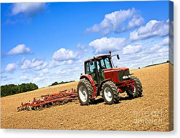 Tractor In Plowed Farm Field Canvas Print by Elena Elisseeva