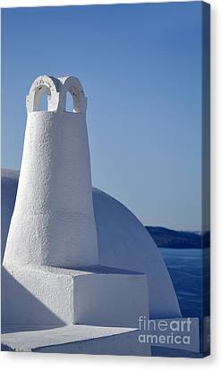 Traditional Chimney In Oia Town Canvas Print by George Atsametakis