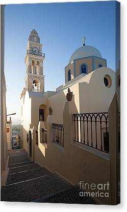 Traditional Church And Street In Santorini - Greece Canvas Print by Matteo Colombo