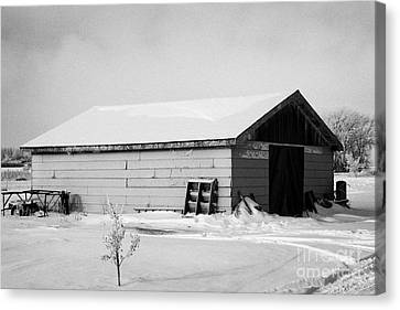 traditional wooden plank barn in rural village Forget Saskatchewan Canada Canvas Print by Joe Fox