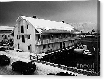 traditional wooden warehouse in Honningsvag harbour finnmark norway europe Canvas Print by Joe Fox