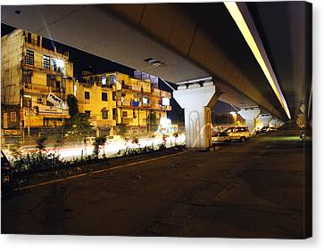 Traffic Running Beneath Flyover Canvas Print by Sumit Mehndiratta