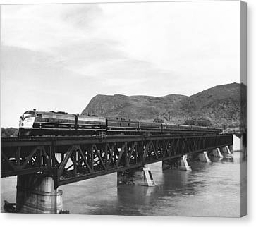 Train Crossing A Trestle Canvas Print by Underwood Archives