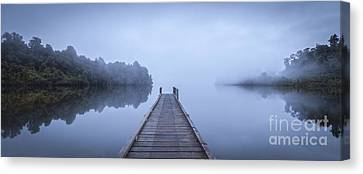 Tranquil Lake And Misty Dawn Panorama Canvas Print by Colin and Linda McKie
