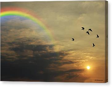 Tranquil Sunset And Rainbow Canvas Print by Jay Harrison