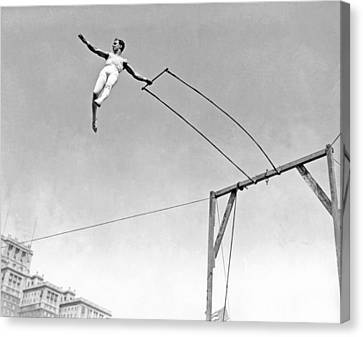 Trapeze Artist On The Swing Canvas Print by Underwood Archives