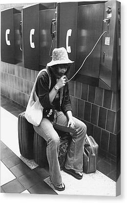 Traveler Talks On Pay Phone Canvas Print by Underwood Archives