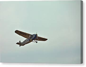 Tri-motor Overhead Canvas Print by Gordon Elwell