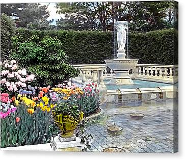 Tulips And Fountain Canvas Print by Terry Reynoldson