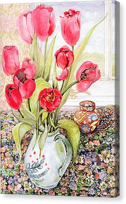 Tulips In A Rye Jug Canvas Print by Joan Thewsey