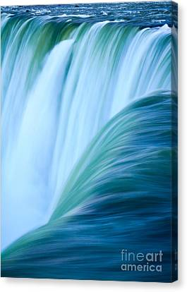 Turquoise Blue Waterfall Canvas Print by Peta Thames