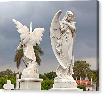 Two Angels With Cross Canvas Print by Terry Reynoldson