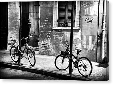 Two Bikes At Night Canvas Print by John Rizzuto