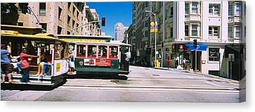 Two Cable Cars On A Road, Downtown, San Canvas Print by Panoramic Images