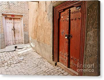 Two Doors In The Old Town Of Kashgar Canvas Print by Robert Preston