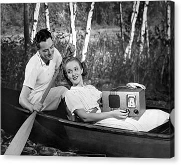 Two Lovers In A Canoe Canvas Print by Underwood Archives