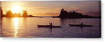 Two People Kayaking In The Sea, Broken Canvas Print by Panoramic Images