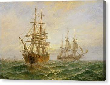 Two Ships Passing At Sunset Canvas Print by Claude T Stanfield Moore