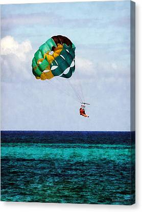 Two Women Parasailing In The Bahamas Canvas Print by Susan Savad