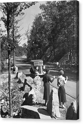 Two Young Women Hitchhiking Canvas Print by Underwood Archives
