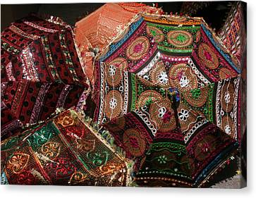 Umbrellas In The Textile Souk  Canvas Print by Kathy Peltomaa Lewis