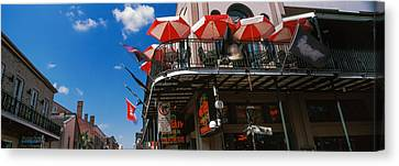 Umbrellas On A Restaurant, Big Easy Off Canvas Print by Panoramic Images
