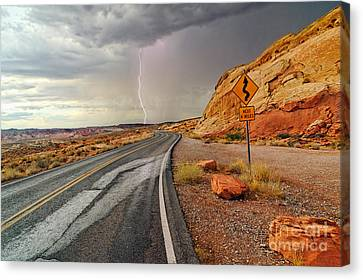 Uncertainty - Lightning Striking During A Storm In The Valley Of Fire State Park In Nevada. Canvas Print by Jamie Pham