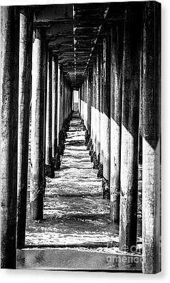 Under Huntington Beach Pier Black And White Picture Canvas Print by Paul Velgos
