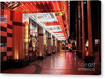 Under The Neon Lights Canvas Print by John Rizzuto