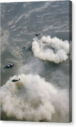 Us Helicopters Landing In Afghanistan Canvas Print by U.s. Marine Corps