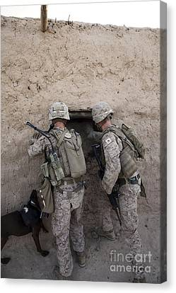 U.s. Marines Push Down A Wall In An Canvas Print by Stocktrek Images
