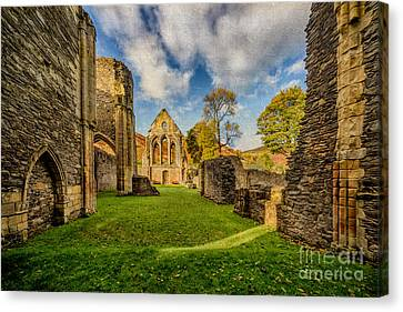 Valle Crucis Abbey Ruins Canvas Print by Adrian Evans