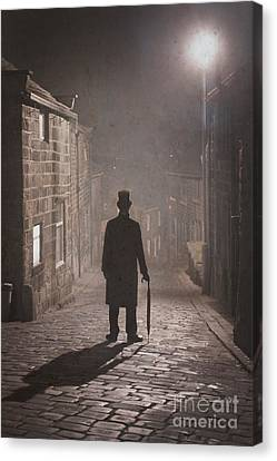 Victorian Man With Top Hat On A Cobbled Street At Night In Fog Canvas Print by Lee Avison