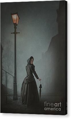 Victorian Woman Under Streetlamp In Fog Canvas Print by Lee Avison