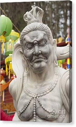 Vietnamese Temple Statue Canvas Print by Jim Corwin