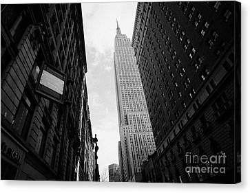 View Empire State Building From West 34th Street And Broadway Junction New York City Canvas Print by Joe Fox