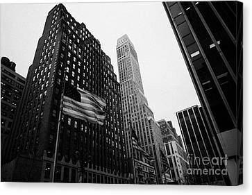 view of pennsylvania bldg nelson tower and US flags flying on 34th street from 1 penn plaza nyc Canvas Print by Joe Fox