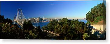 View Of The Bay Bridge And Downtown San Canvas Print by Panoramic Images