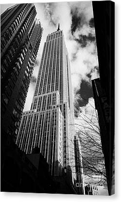 View Of The Empire State Building And Surrounding Buildings And  Cloudy Sky From West 33rd Street Ny Canvas Print by Joe Fox