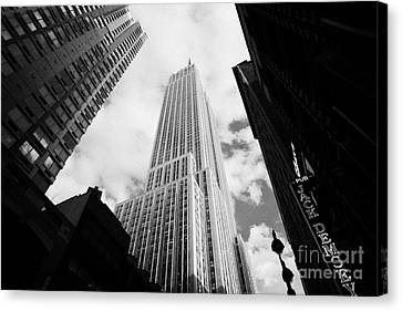 View Of The Empire State Building And Surrounding Buildings And Cloudy Sky West 33rd Street New York Canvas Print by Joe Fox