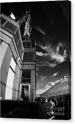 View Of The Top Of The Empire State Building Radio Mast And Tourists On Observation Deck New York Canvas Print by Joe Fox