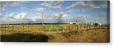 View Of Wind Turbines In Farm Canvas Print by Panoramic Images