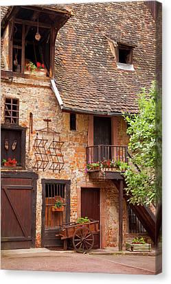 Village Street Scene In Colmar Canvas Print by Brian Jannsen