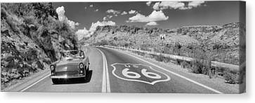 Vintage Car Moving On The Road, Route Canvas Print by Panoramic Images