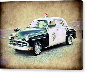 Vintage Plymouth Cop Car Canvas Print by Steve McKinzie