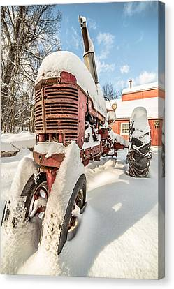 Vintage Red Farmall Tractor In The Snow Canvas Print by Edward Fielding