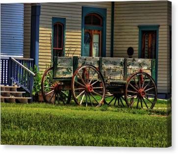 Wagon In The Old West Canvas Print by Dan Sproul