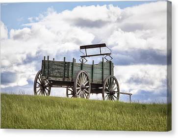 Wagon On A Hill Canvas Print by Eric Gendron
