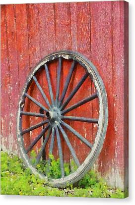 Wagon Wheel On Red Barn Canvas Print by Dan Sproul
