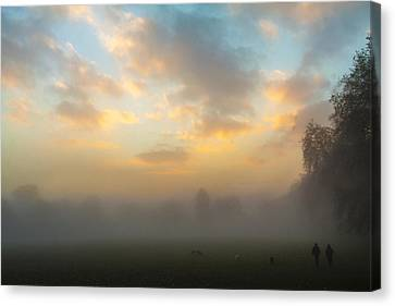 Walkers In The Fog Canvas Print by Matthew Bruce
